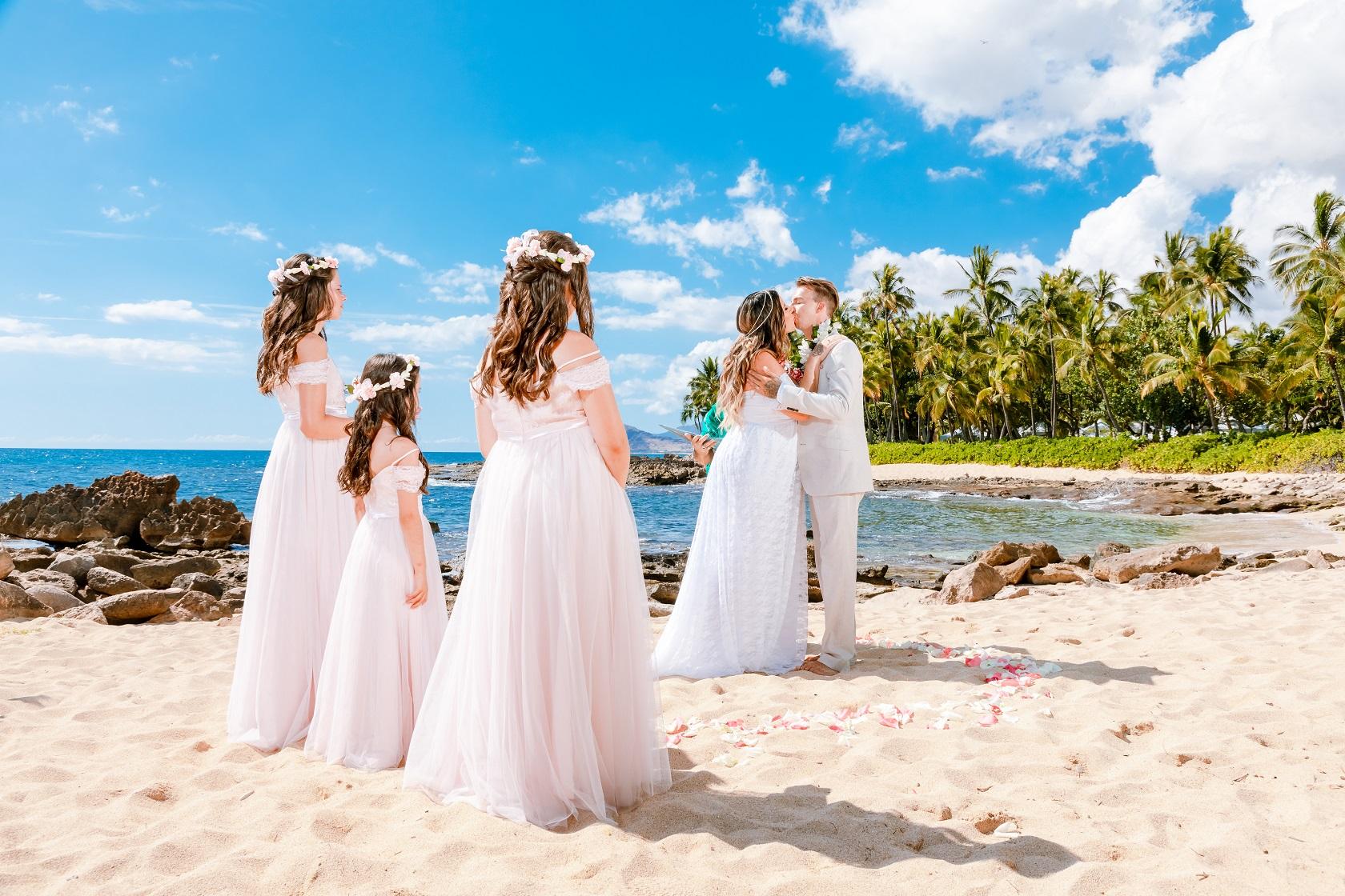 bride and groom wedding kiss oahu beach ceremony