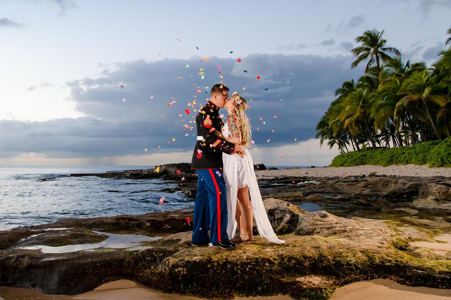 bride groom portrait sunset beach flower petal shower