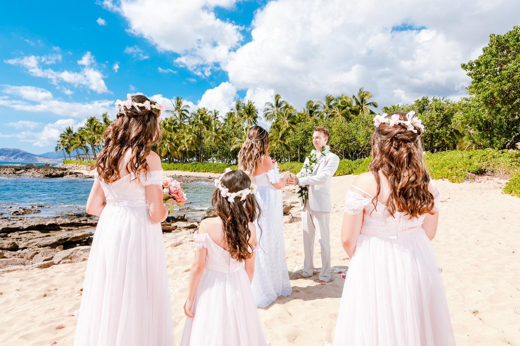 sunny oahu hawaii wedding day beach ceremony flower girls