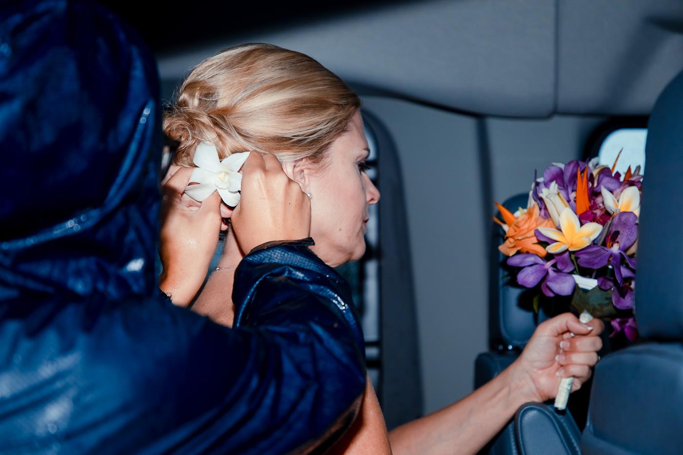 bride getting prepped in van