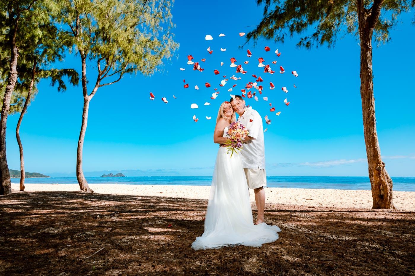 bride and groom wedding portrait oahu beach flower petals
