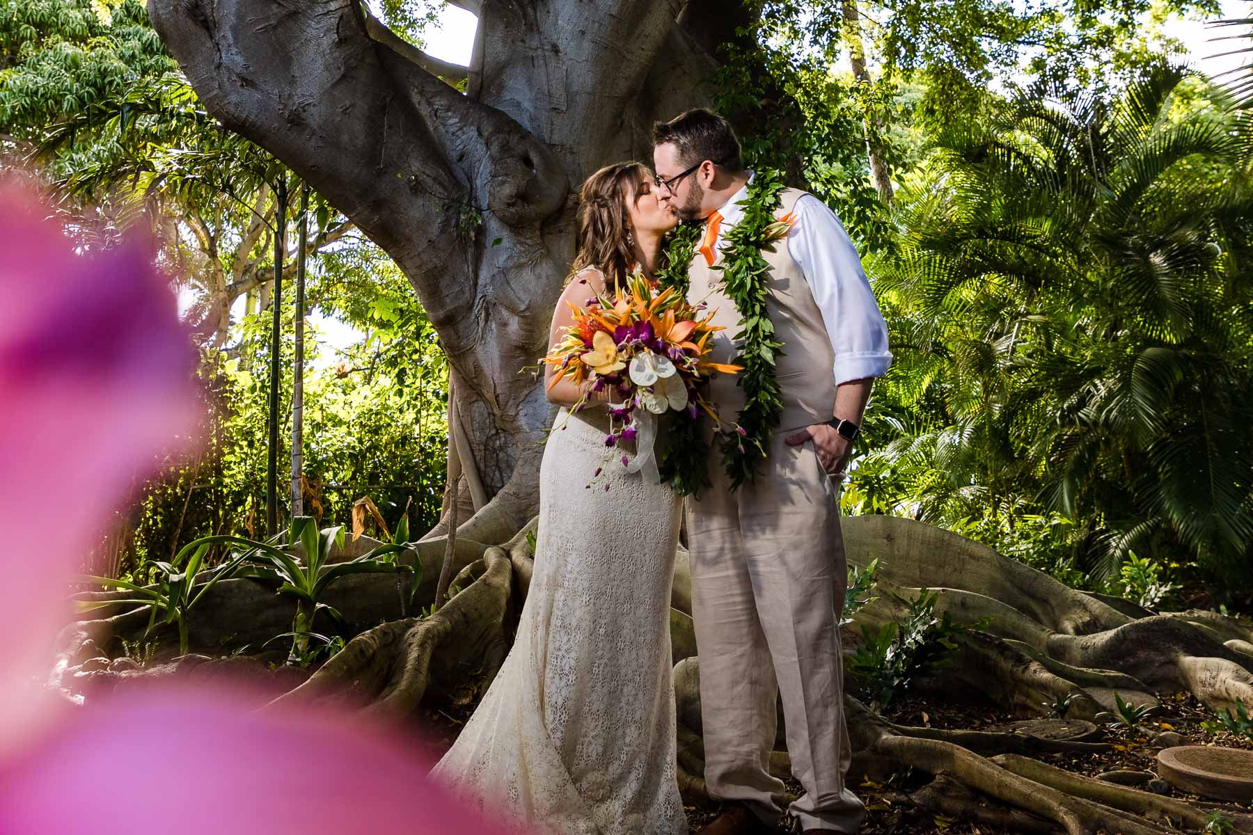 backyard garden wedding portrait of bride and groom flowers trees