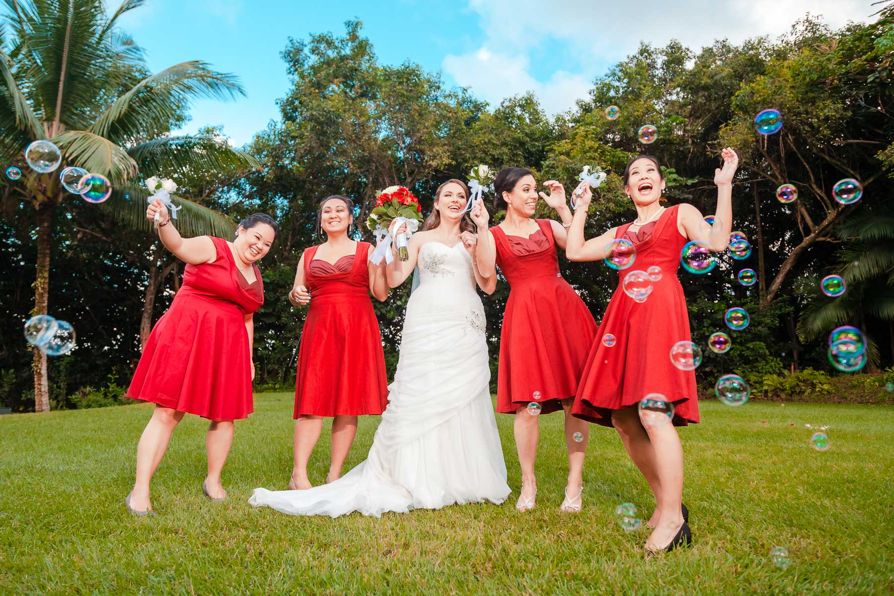 bride and bridesmaids wedding portrait with bubbles