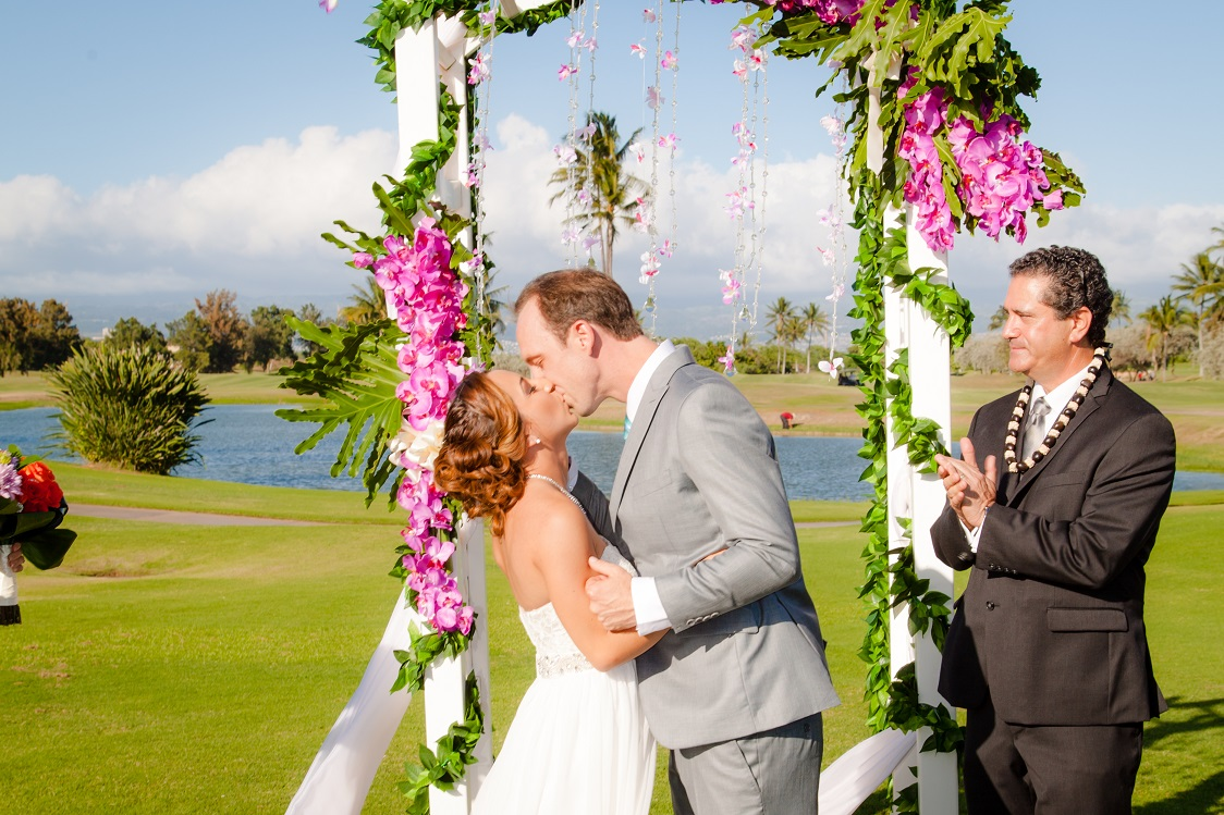 first kiss bride and groom wedding ceremony just married
