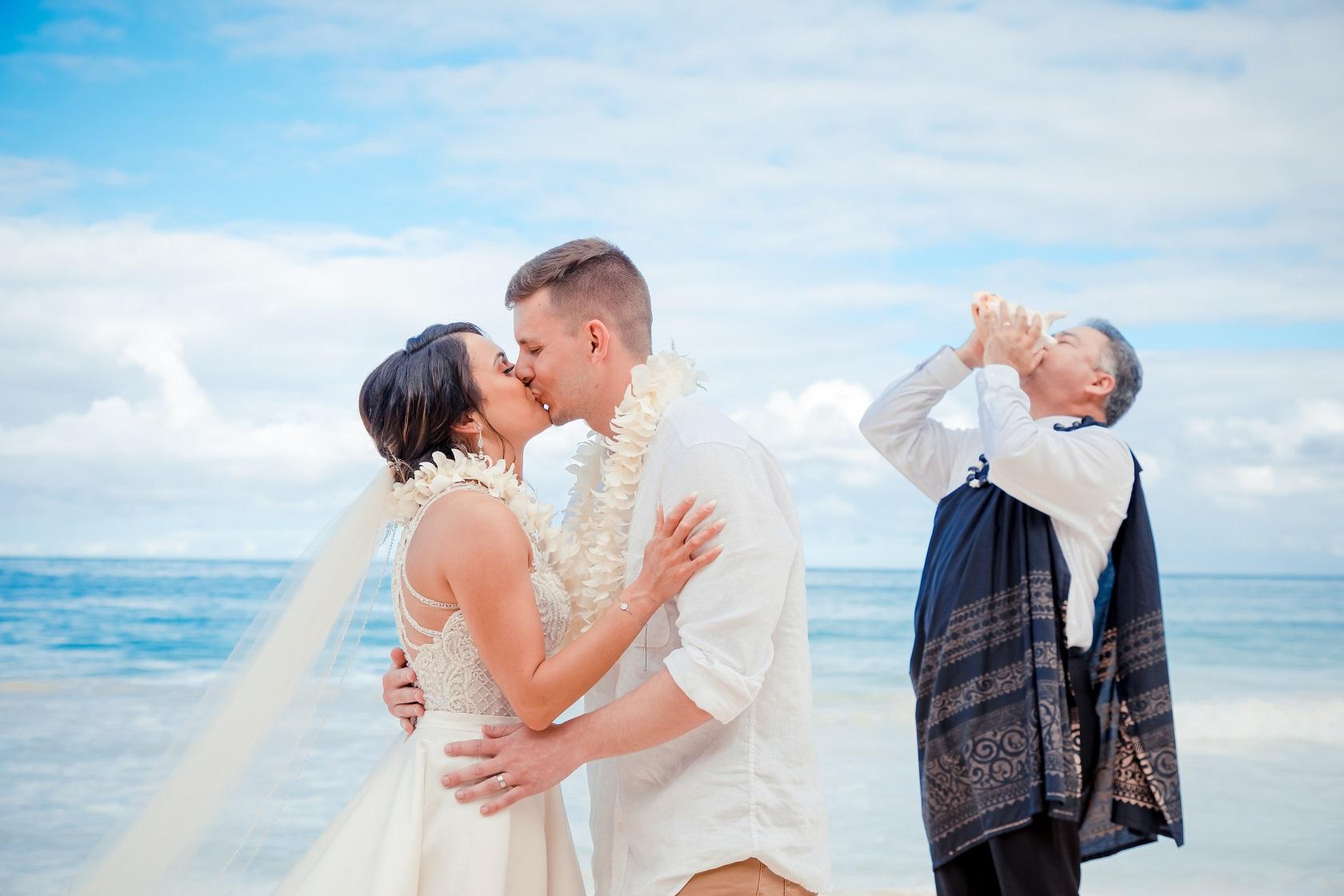 oahu beach elopement wedding ceremony bride and groom wedding kiss