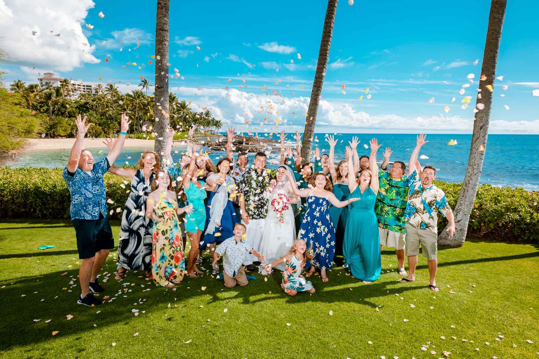 after wedding bridal party celebration flower petal shower oahu hawaii beach