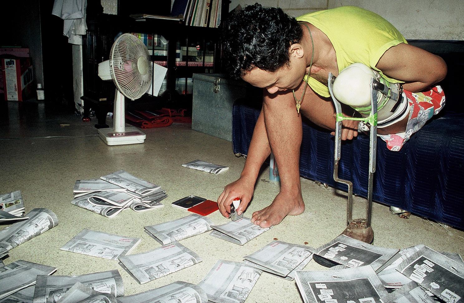 90s - Man working on a illegal underground newspaper in Myanmar (formerly Burma)