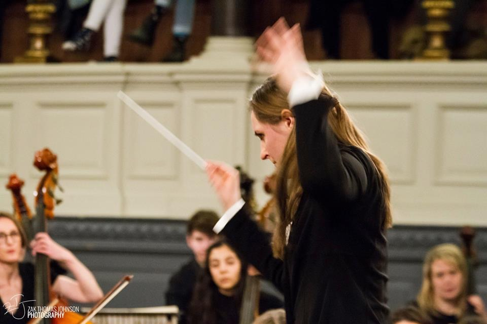 Hannah schneider - Music directorNoted for her 'powerful flair' and 'elegant exactitude', Hannah Schneider is assistant conductor of the Oxford Philharmonic Orchestra (2018-2020) and founder and music director of Oxford Alternative Orchestra. She conducts professionally in Russia, the UK, the United States, and the Ukraine, including engagements in 2019-2020 with the Lviv Philharmonic Orchestra, Yakutsk Philharmonic Orchestra, Chelyabinsk Philharmonic Orchestra, Kaluga Young Symphony Orchestra, Smolensk Regional Philharmonic Orchestra, So&So, and Ballet Hartford (USA).She studied violin performance at Moscow's Tchaikovsky Conservatory until an injury prompted her to change direction and earn a bachelor's degree from Georgetown University in Russian literature. She found her way back to music when Valery Gergiev hired her as one of his personal administrative assistants at the Mariinsky Theatre in 2015. Through his mentorship and encouragement as she worked on programming, tours, and festival assisting, she also began to turn her attention to conducting, and started training in St Petersburg with Leonid Korchmar. Gergiev continues to be one of her most important mentors. In addition, she is coached by Karen Kamensek, and has participated in masterclasses with Paavo Järvi.In 2016, she won a Rhodes Scholarship to attend the University of Oxford, where she is currently finishing her doctorate in Soviet Opera, focusing on the canon of composer Rodion Shchedrin.