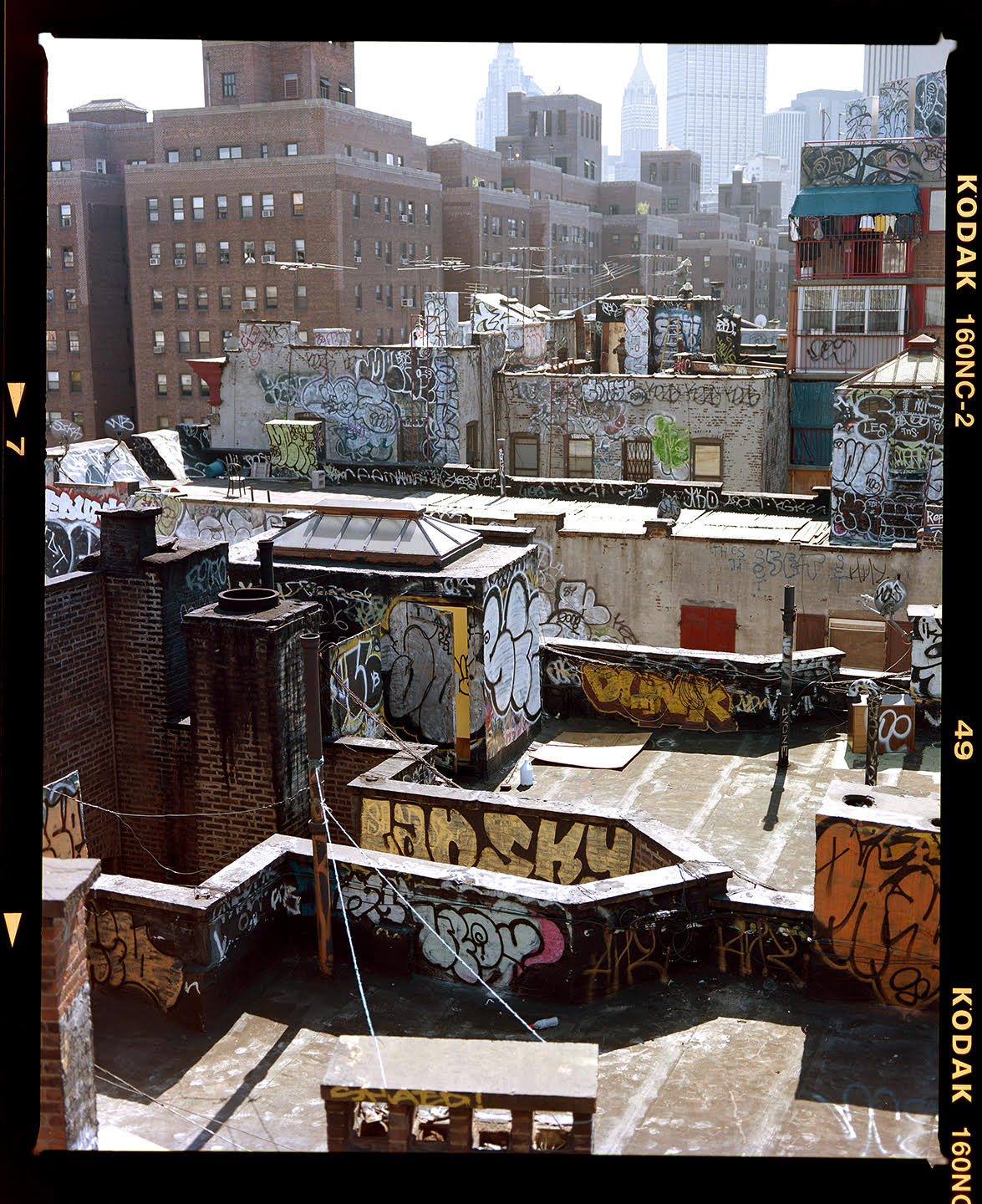 """""""This is my favourite of my shots from New York. Taken from the Manhattan Bridge I love all the layers in this shot. From the graffiti in the foreground, to the men working on the rooftops, to the Empire State Building in the background. I never get tired of this shot"""""""