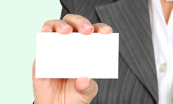 Image description: Hand holding blank business card.