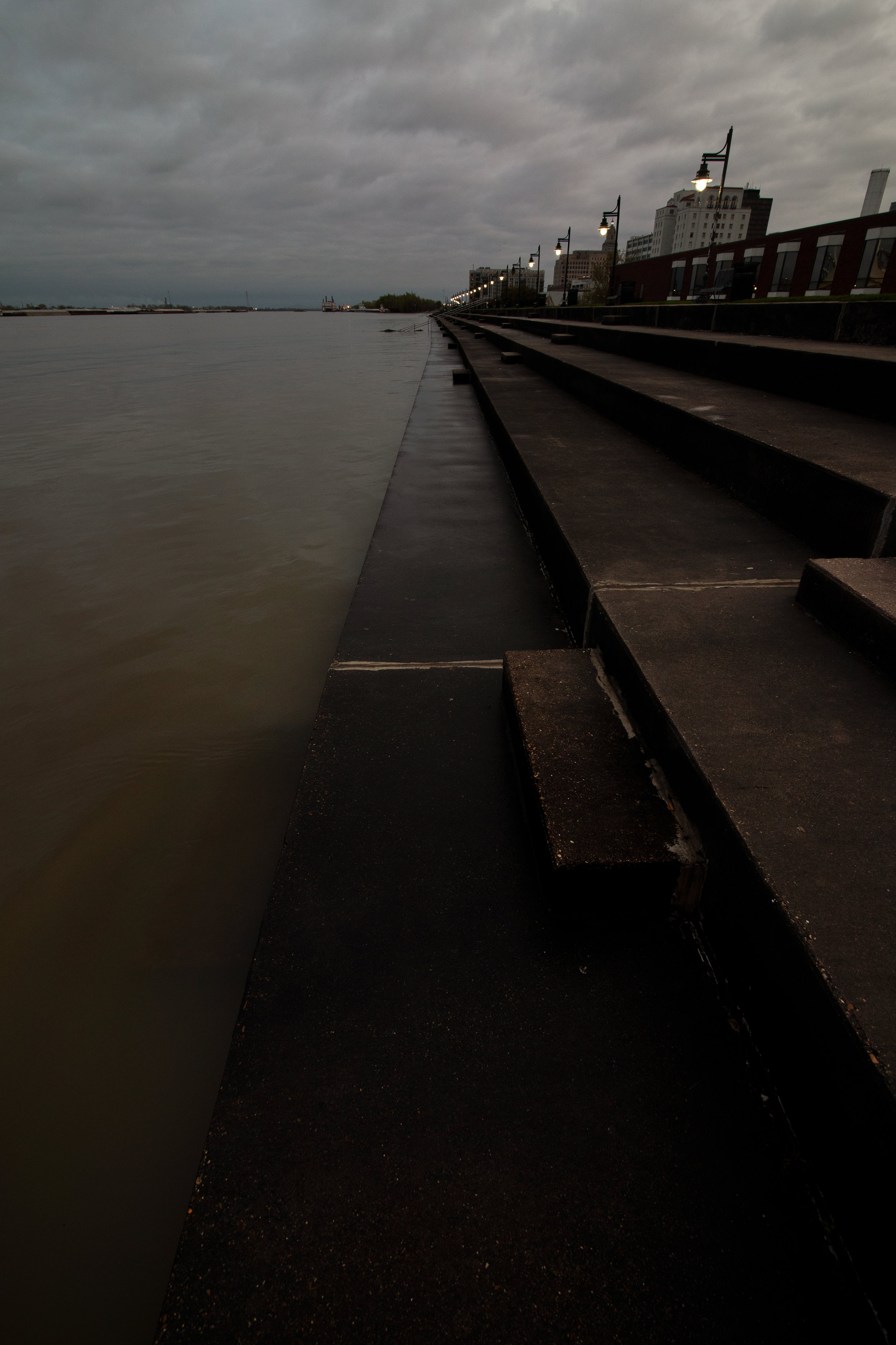 Floodwaters climb the levee near downtown Baton Rouge.