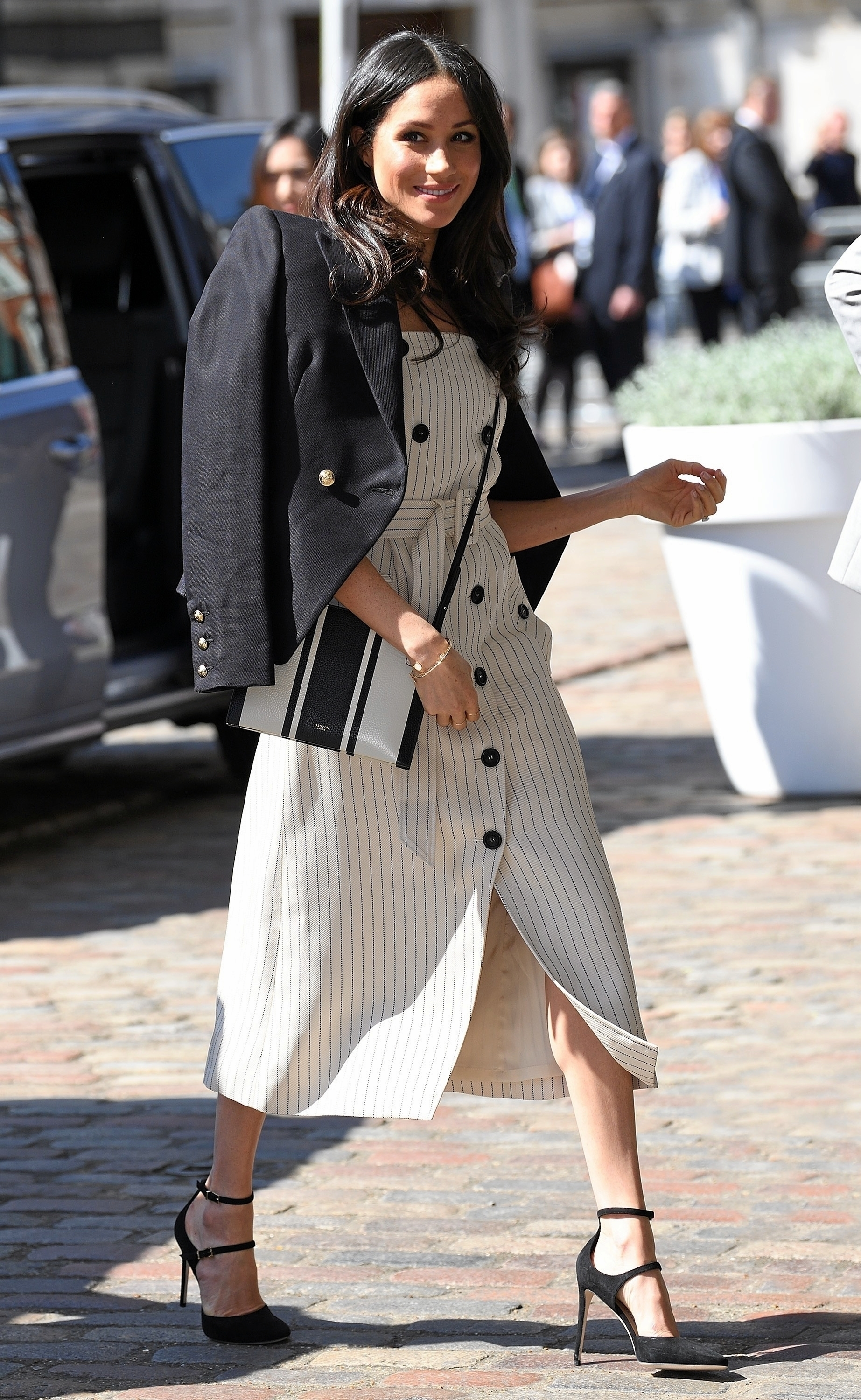 The Duchess of Sussex Meghan Markle attending the Commonwealth Youth Forum Reception in this chic Altuzarra Studio Audrey Dress