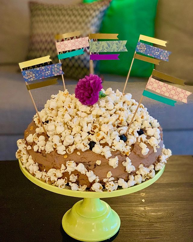 """Housewife in da house✌🏻 YES, I fu***ng did it! A kick ass Birthday Cake for my @vildeesofie (soon to be 19 years, tomorrow) birthday party 🥳💕: Chocolate Cake with Salted Caramel Popcorn🍿🍫🍰. Blueberry, Chocolate Cream hidden inside👊🏻. Happy birthday """"muslingen"""", @vildeesofie love you to the moon and back ❤️❤️. [The awesome secret reception is from my dear friend, @lemonlylove 💕]. @charlotte_rice / @ricedk #birthdaycake #chocolatecake  #thestepfordwives #housewife 😅😂😂"""