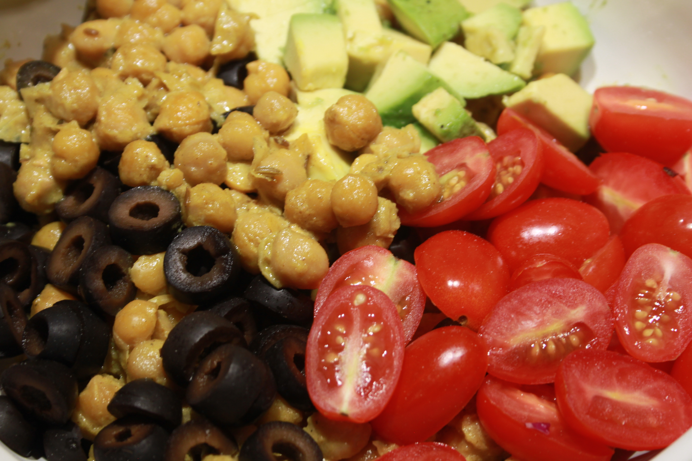 Chickpea Burrito Bowl - $10 - Curried chickpeas topped with veggies and sour creamIngredients: Chickpeas, Coconut Cream, Tomatoes, Olives, Avocado, Sour Cream, Curry Powder, Turmeric, Cumin, Sea Salt, Oregano, Grapeseed Oil
