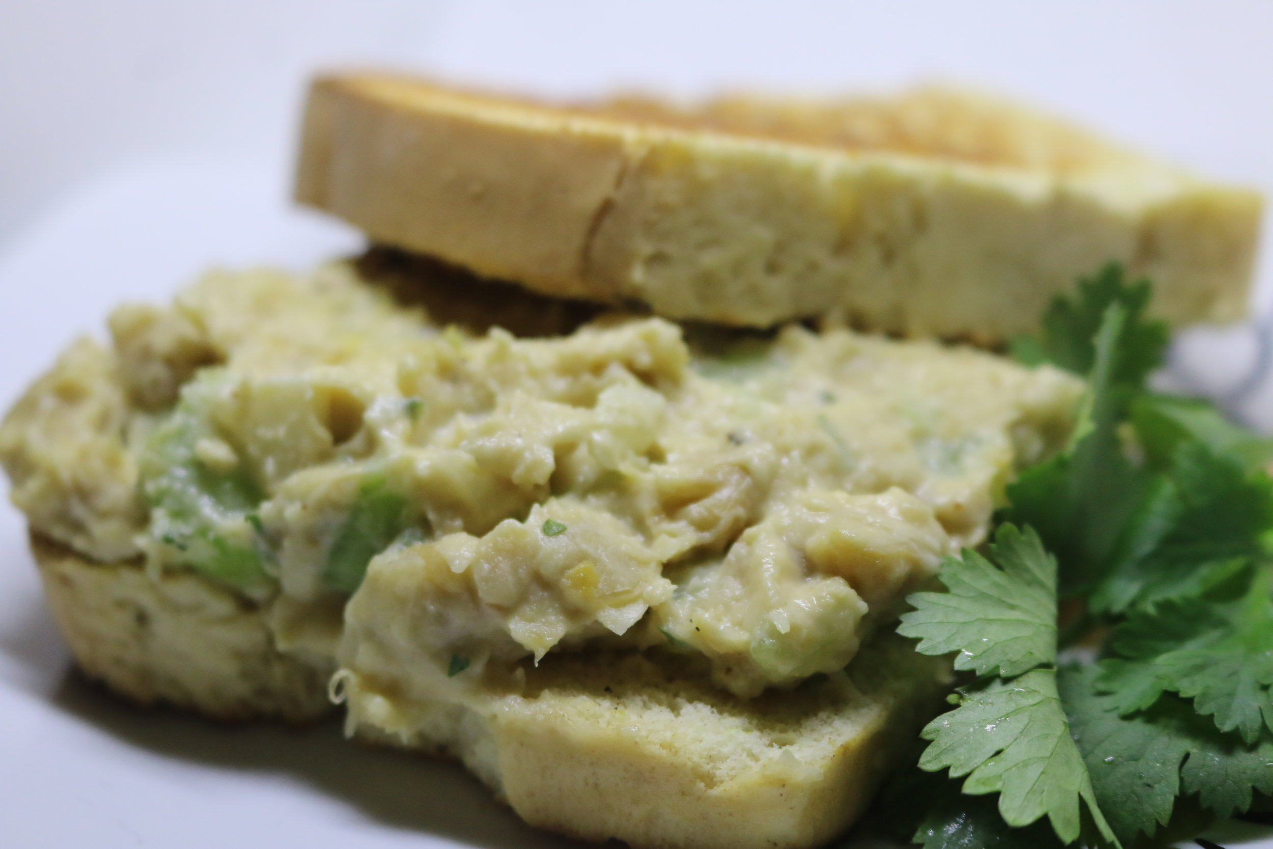 "Chickpea Tuna Salad Sandwich - $9 - Our homemade ""tuna"" salad made of chickpeas and sandwiches in our homemade spelt breadIngredients: Chickpeas, Celery, Onions, Mayo, Mustard Powder, Sea Salt, Cumin, Kelp, DIll, Parsley, Paprika"