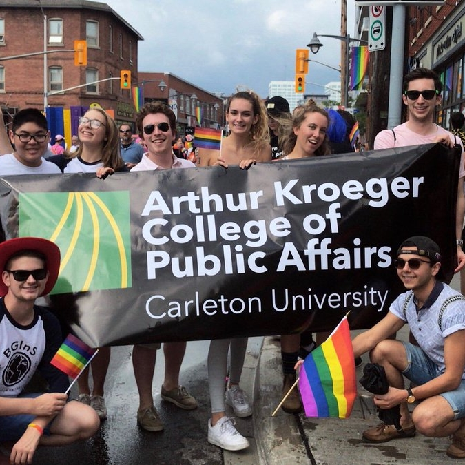 Members of AKCESS and the BGInS Students' Society posing at the beginning of the 2018 Capital Pride Parade.