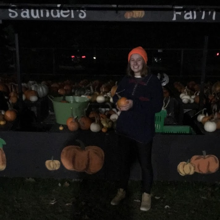 (My friend Laura holding a pumpkin after we got too scared of the haunted houses)
