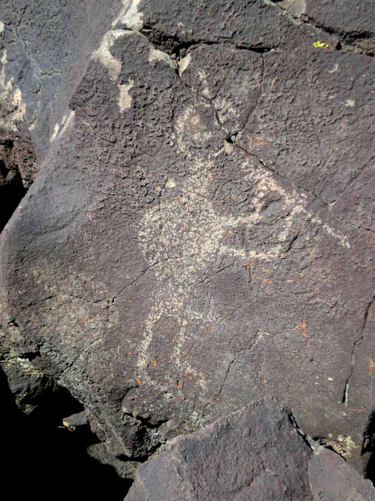 An image of   Kokopelli  , a fertility god often shown playing a flute.  (CC BY-SA 3.0)