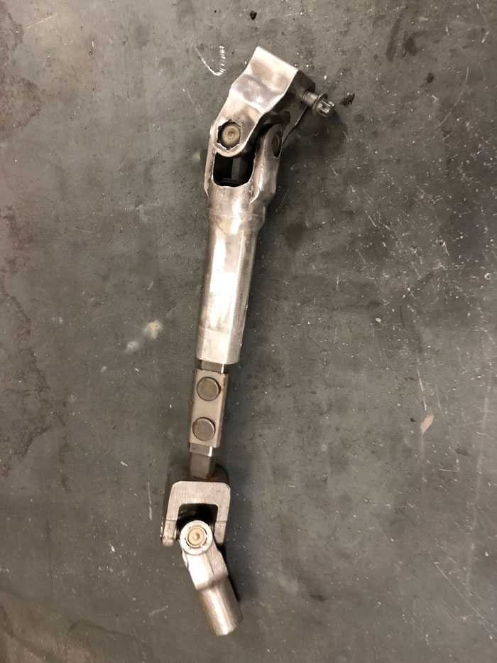 Here's our Frankenstein steering linkage. Starts as a BMW on top, then mates to VW linkage on bottom to connect to the steering rack.