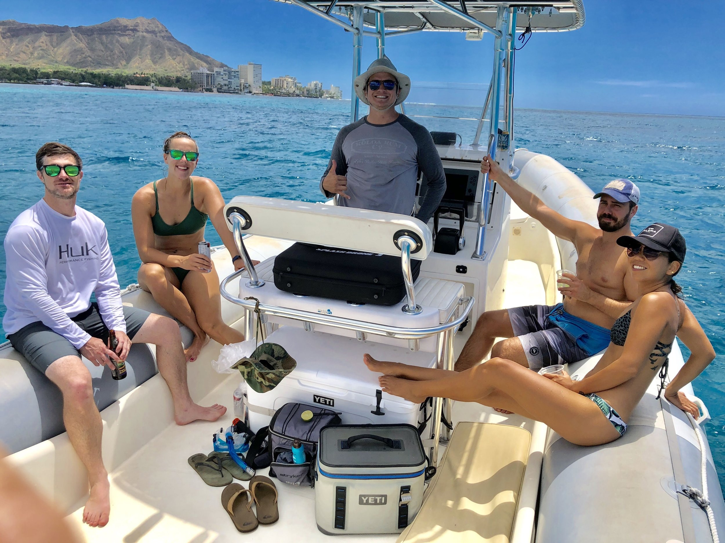 charter boat crew and guests enjoying a private boat tour in Waikiki near Diamond Head