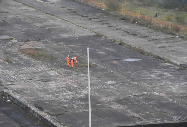 Three workers inspecting the future HS2 site off Curzon Street  (Image: Darren Quinton / Birmingham Live)