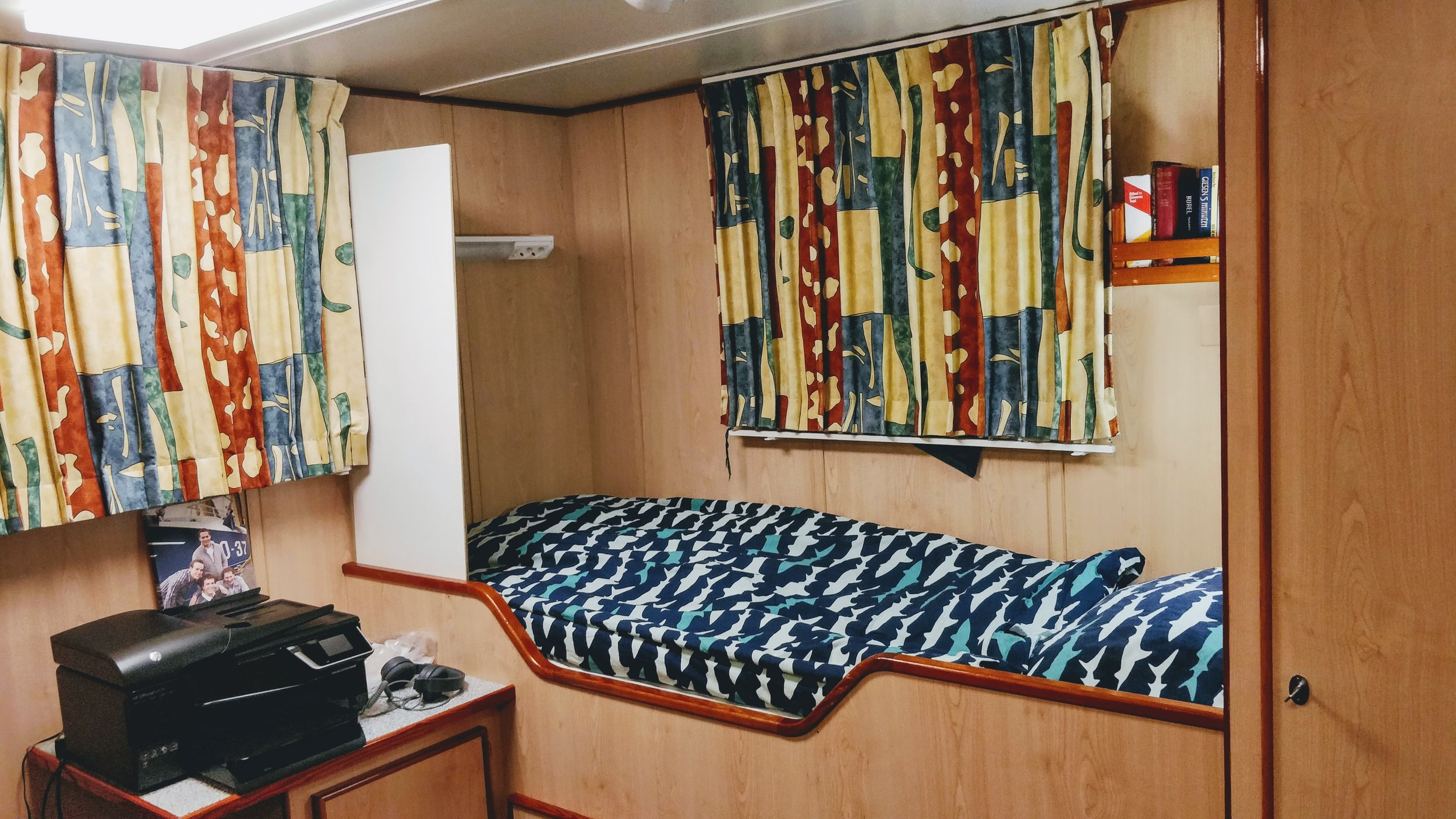 My cabin for the coming days, including bedding with a shark pattern.