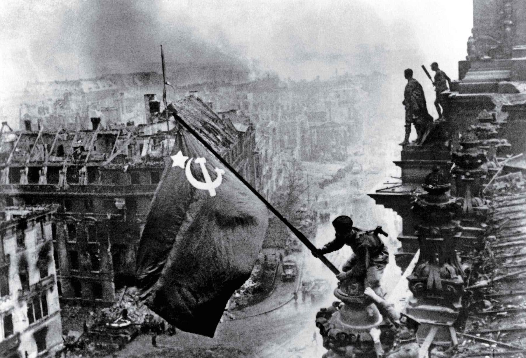 Raising a Flag over the Reichstag by Yevgeny Khaldei (1945)
