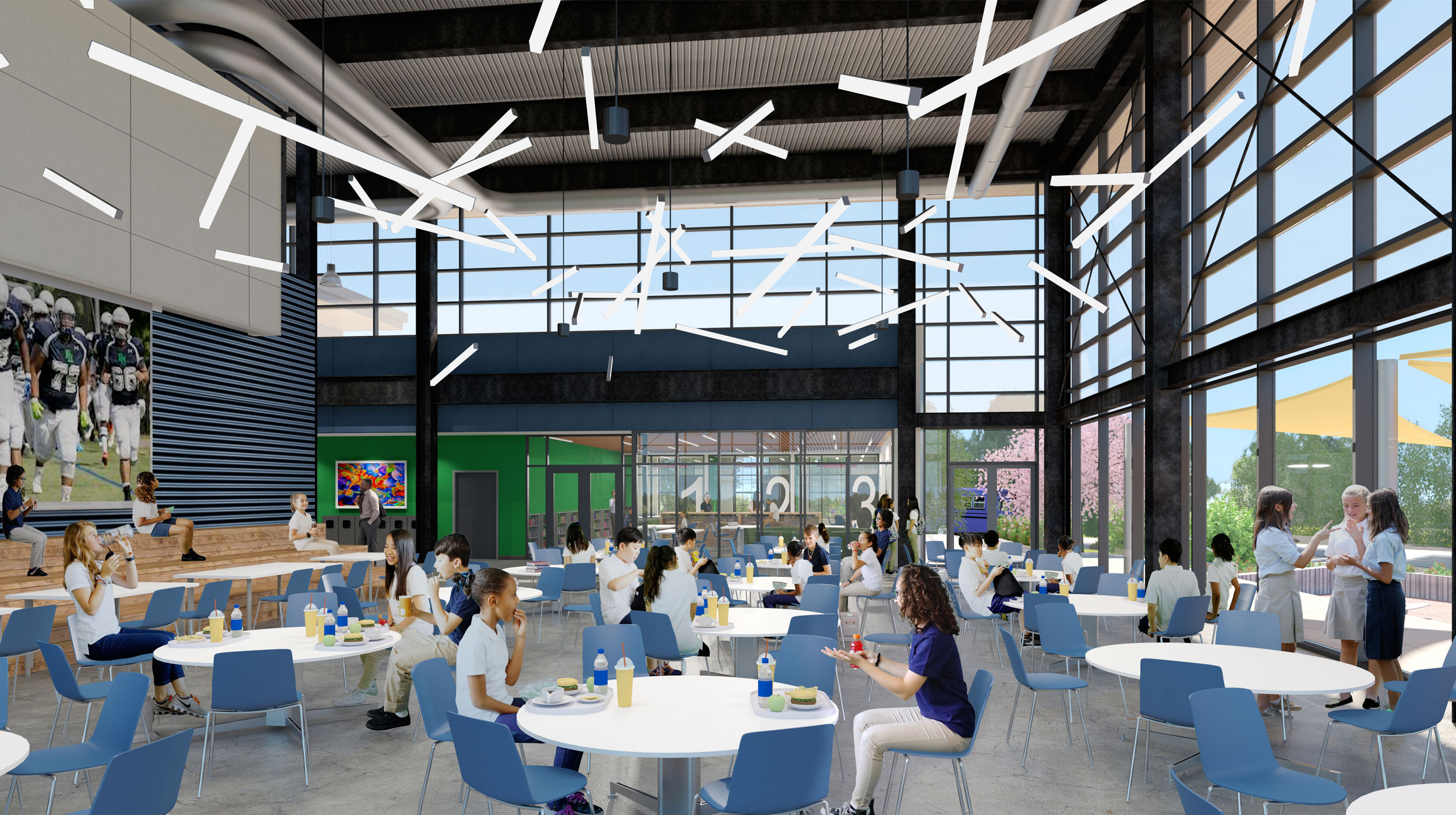 The Commons  — the heart of the new building — is a cafeteria, a meeting space, and a place to celebrate our unique community. At rear, behind a soundproof glass wall, is the Learning Commons, a place for studying, reading, dreaming.