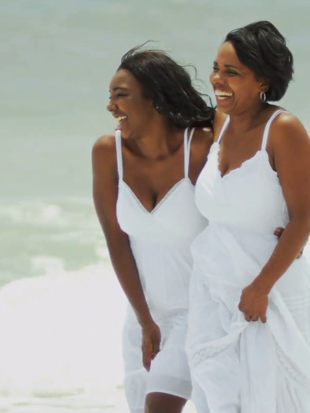 happy-diverse-mother-and-daughter-laughing-playing-in-surfs-on-beach_v1oe8vvyg__F0000.png