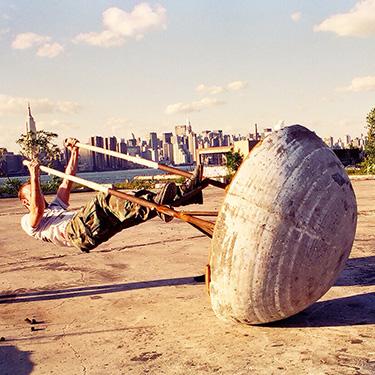 Human Weeble Wobble (1995/2018) concrete, steel. Performance still 1995.