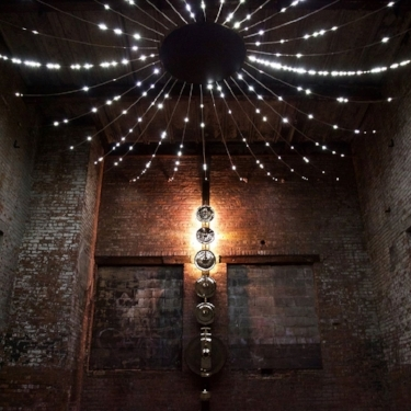Gamelatron Suara Sinar (The Sound of Light) (2017). Mechanical gongs synchronized with a constellation of lights; circular foam platform for lounging. Installation view, The Chimney.