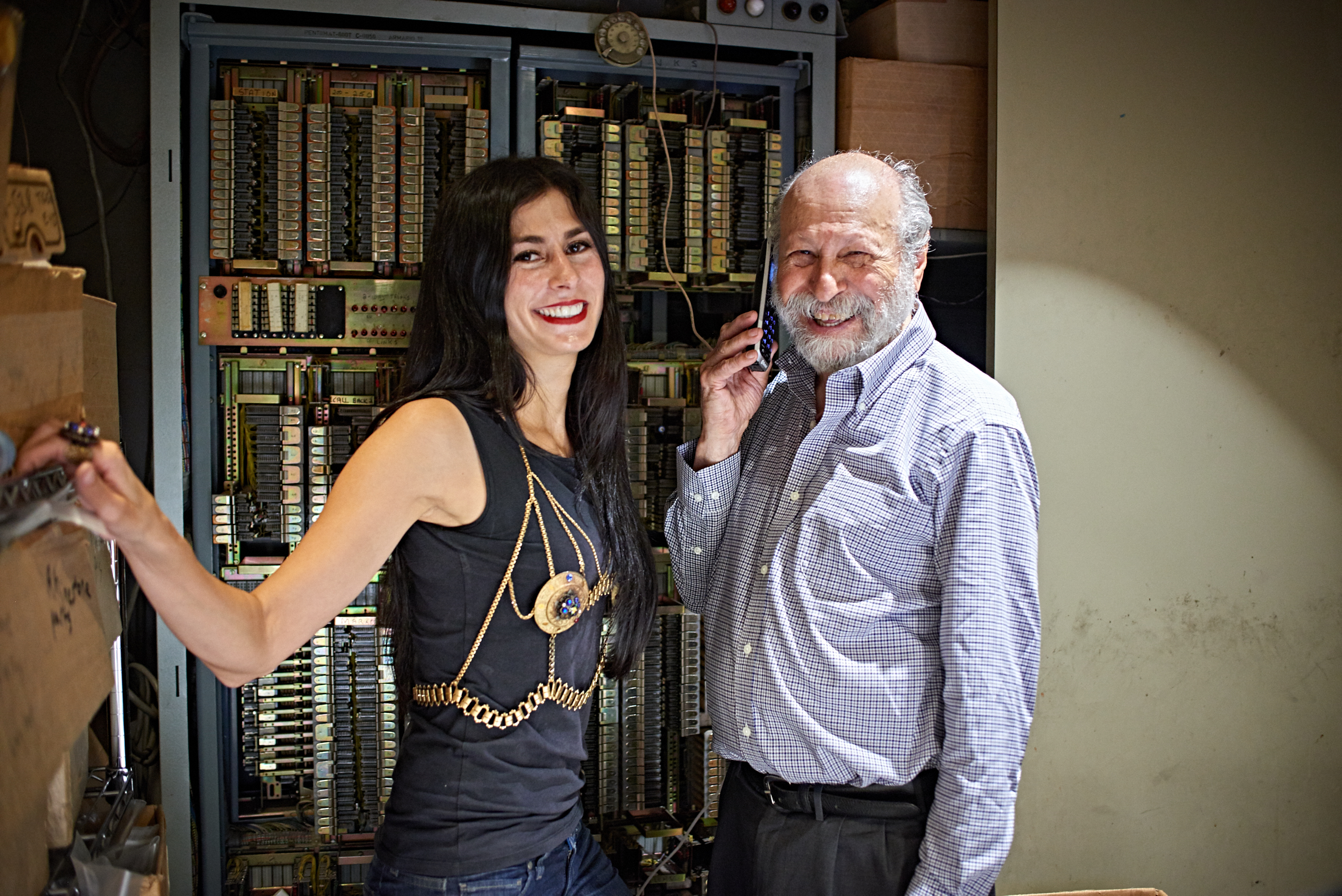 Elyse and Carl in front of the original telephone system when Carl first moved into the building in 1950. Although no longer in use, it is still intact.