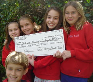 2004-Kling-Street-Kids-with-3001-donation-check-007-300x266.jpg