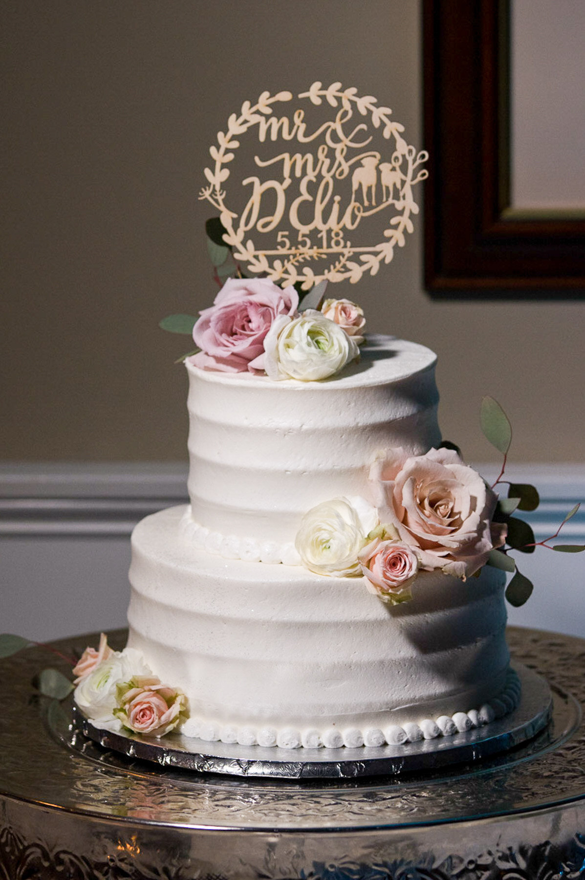 Jenna and Rick's decadent wedding cake presented during the reception at the Brant Beach Yacht Club