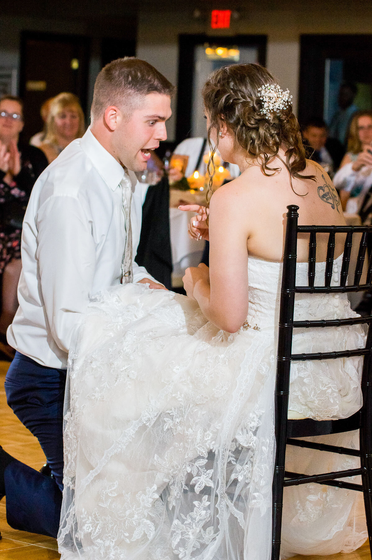 Ray getting rather excited as he tries and removes the garter from Lindsay's leg at the Latitudes on the River