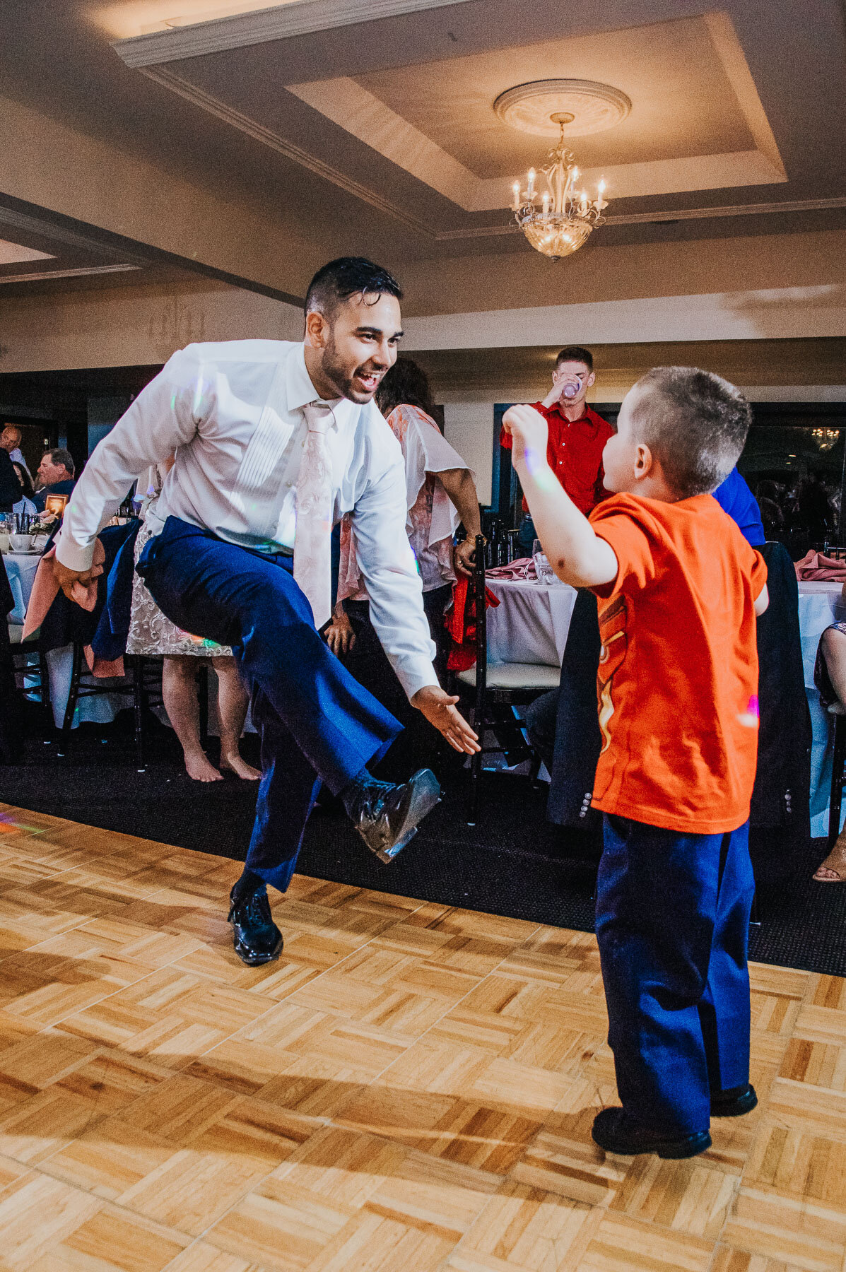 Lindsay's son having a dance off with a fellow guest at Latitudes on the River