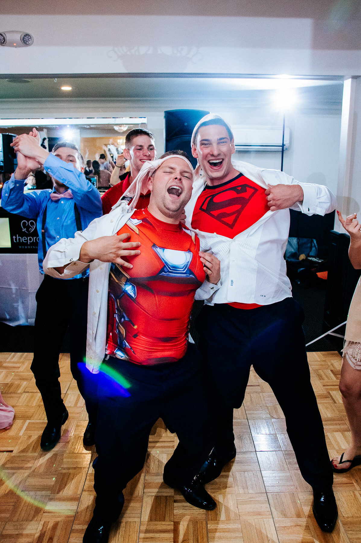 After hours of dancing, it does get hot! The groomsmen ripped off their shirts, showing some superhero love at Latitudes on the River