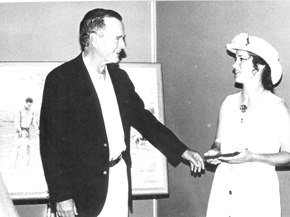 """Nicole Kroeger presents her painting """"A Measure of Success"""" to George Bush Sr. 1995."""