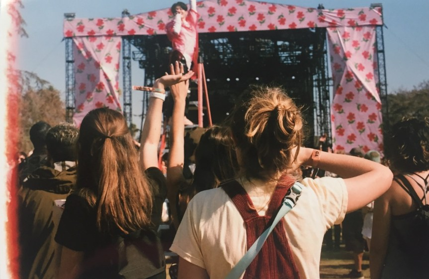 Watching Wednesday Campanella, having never heard of her before. She stood on a red ladder in the middle of the crowd, the sleeves on her shirt extending a foot past her hands, flailing her arms around. Let me just say we couldn't take our eyes off her.
