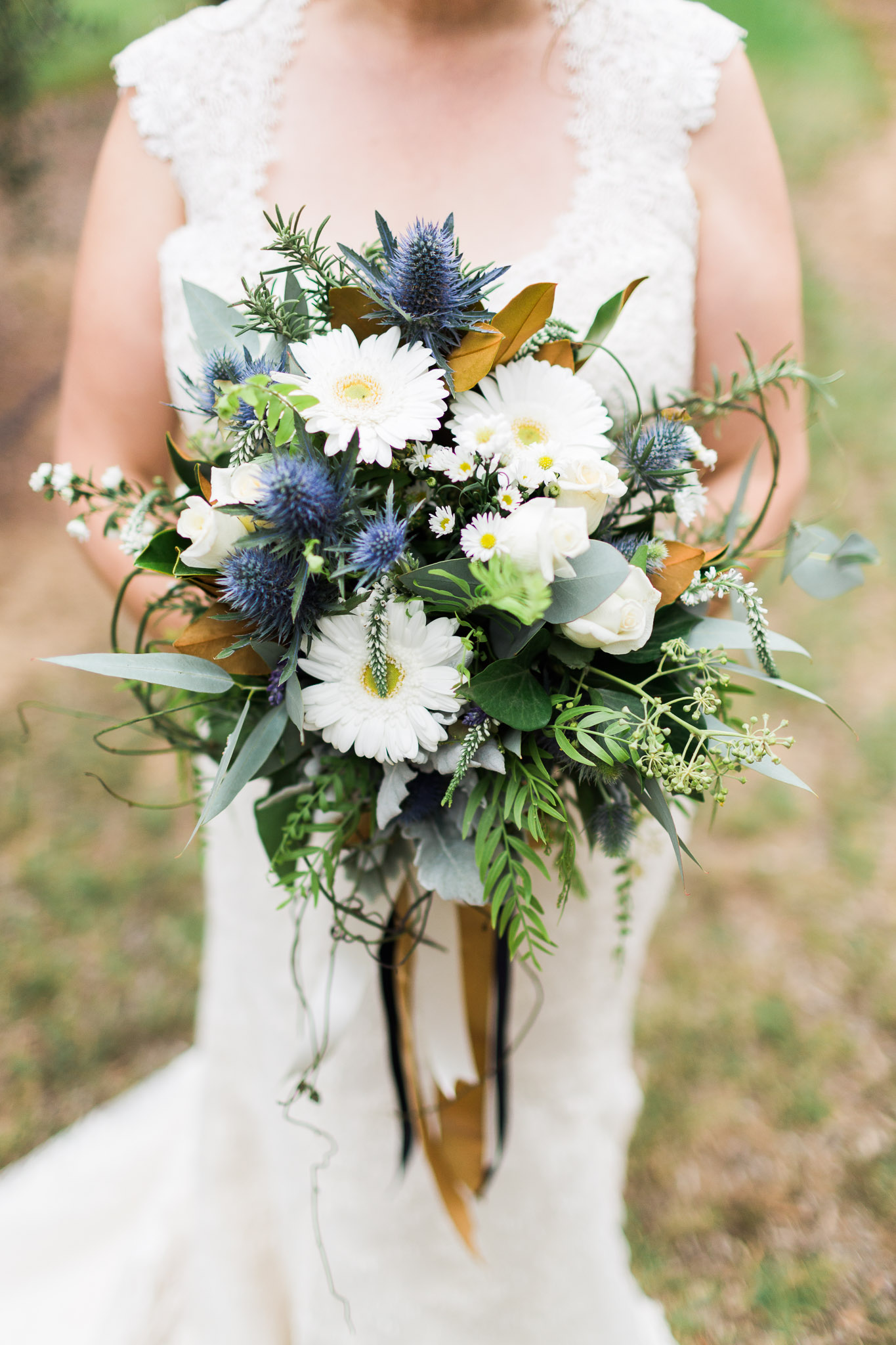 A bride holding an unstructured style of wedding bouquet in Canberra.
