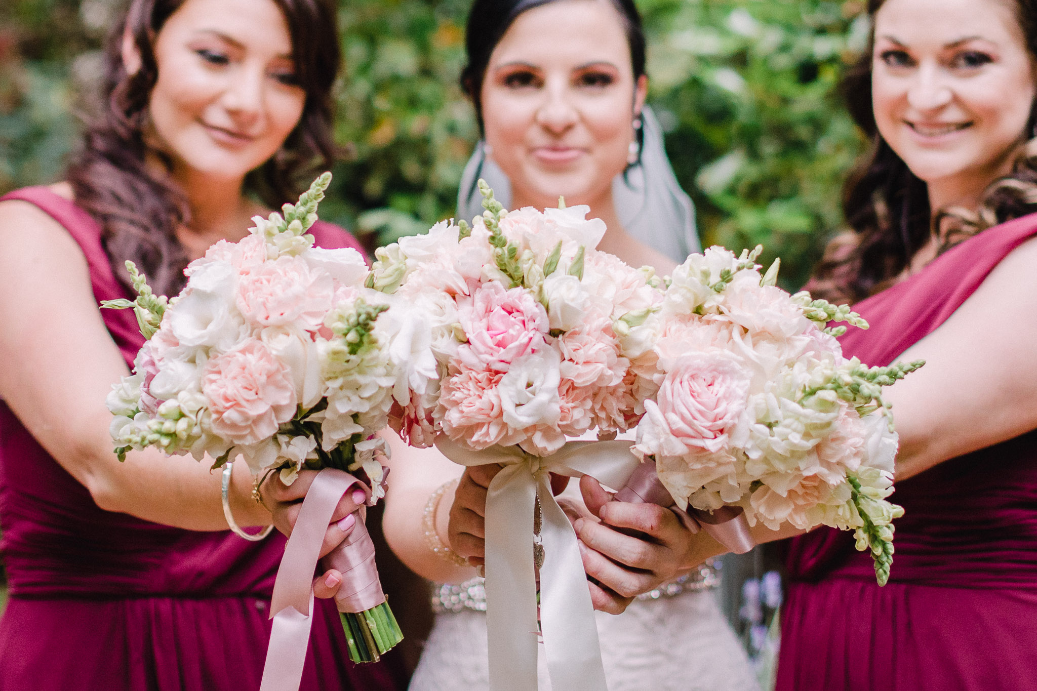 Bride and Bridesmaids holding flowers from their Canberra Wedding.