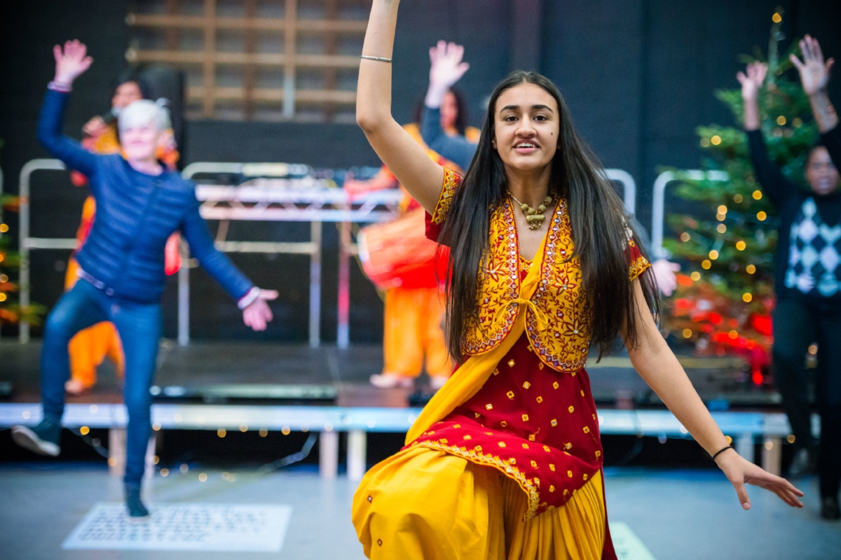 One of Parv Kaur's dancers shows the crowd what to do at the Festival of Masters - image by Dee Patel