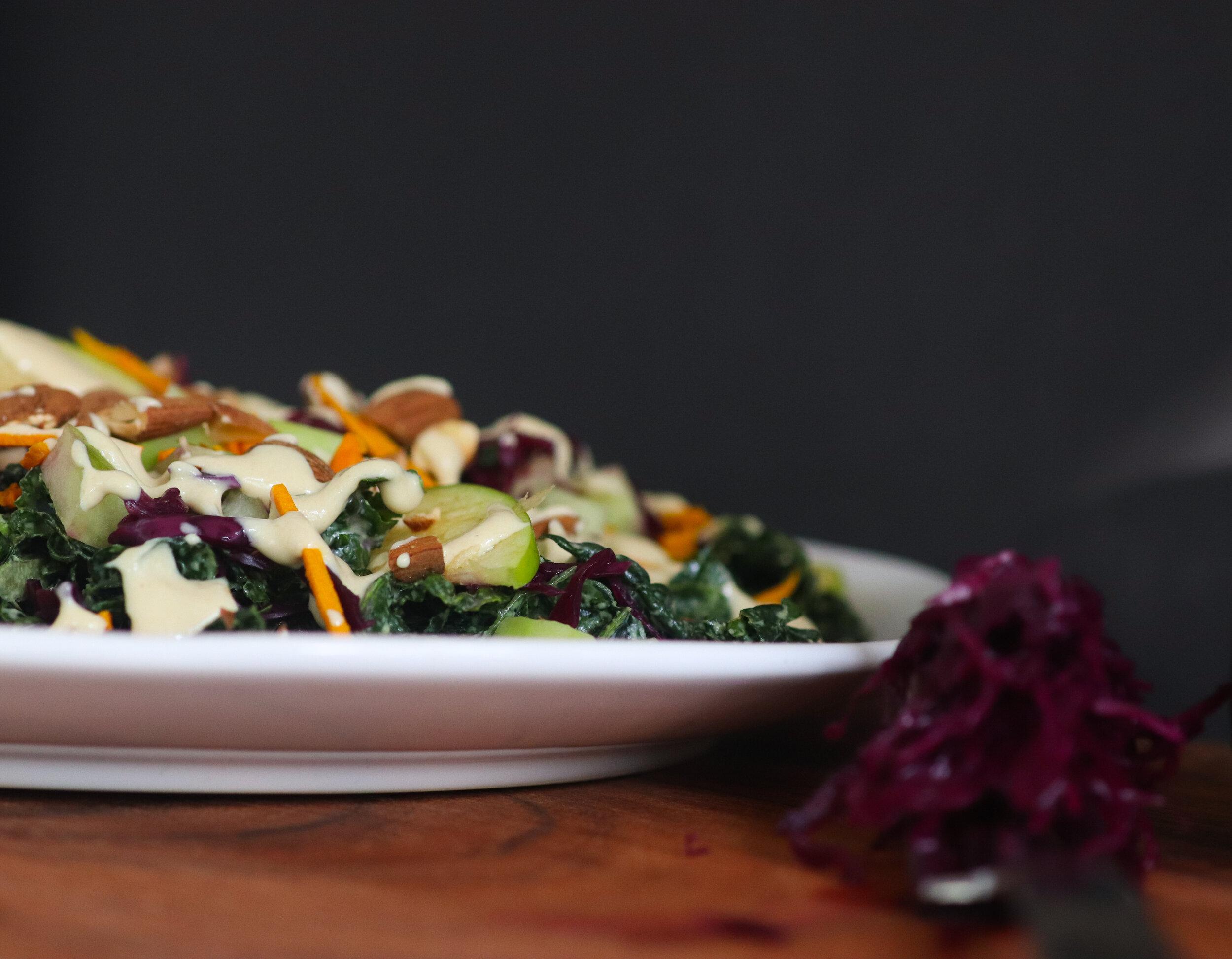 plant based, vegan, gluten free, oil free, tahini dressing, kale and apple salad, saurkraut, tumeric.jpg