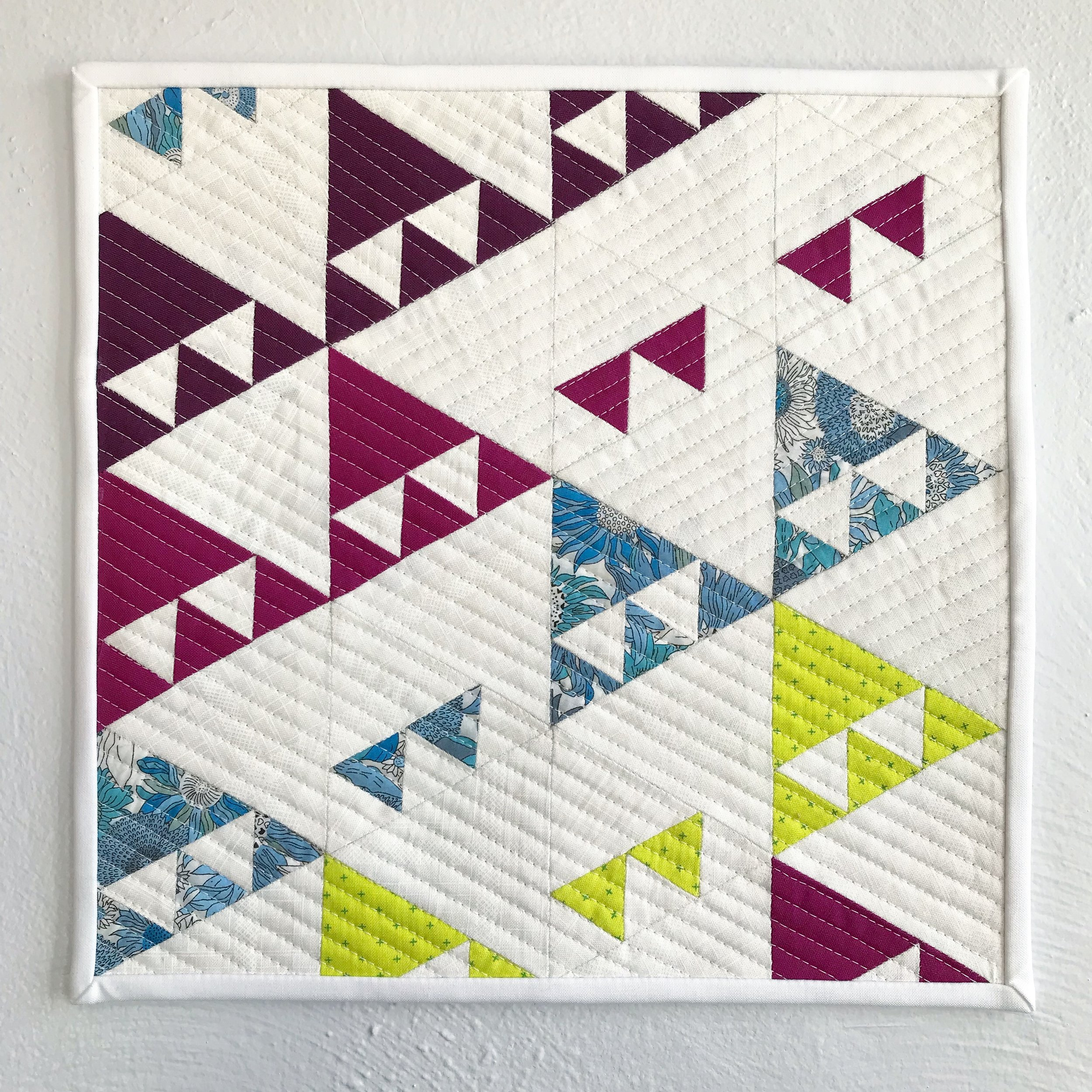 """Climb That Mountain   Hand-stitched, machine quilted. 13"""" square.  Made for  Curated Quilts  mini-challenge, Issue 4.  2018"""