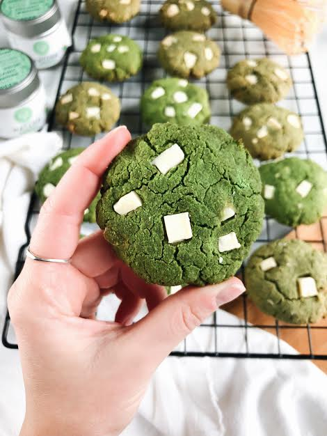 Matcha Cookies - 2 cups Almond flour¼ cup Coconut flour½ cup coconut shreds1 tsp. Baking soda2 tbsp. Matcha powder1 egg½ cup coconut oil (melted)1 tbsp. coconut butter1 tsp. vanilla extract¼ organic white chocolate chunksMETHOD1. Preheat oven to 350 degrees.2. Line cookie sheet with parchment paper or use cooking spray.3. Combine all wet ingredients into a bowl and all dry ingredients into another bowl.4. Once mixed, combine the wet ingredients into the dry ingredients and mix until dough forms. Fold in white chocolate chips and roll cookie dough into balls.5. Press the balls down into cookies and bake in the oven for 10 minutes.6. Let cool and enjoy
