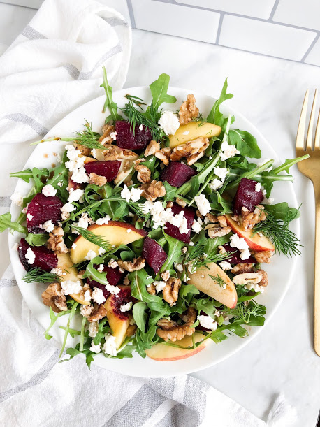 Roasted Beet and Arugula Salad - 3 cups arugula (washed)1 beet1 apple1/4 cup walnuts1/2 cup feta3 tbsp fresh Dill1 tbsp avocado oil (sub for other oils)1/4 Balsamic dressingMethod1) Turn on oven to 350 degrees. While oven is heating, peel and chop beets into small cubes, toss in oil and roast in the oven for 25-30 minutes.2) While beets are roasting, chop up all of the other ingredients and add to a salad bowl. 3) Remove beets from oven, add to salad bowl and toss together with a balsamic dressing.