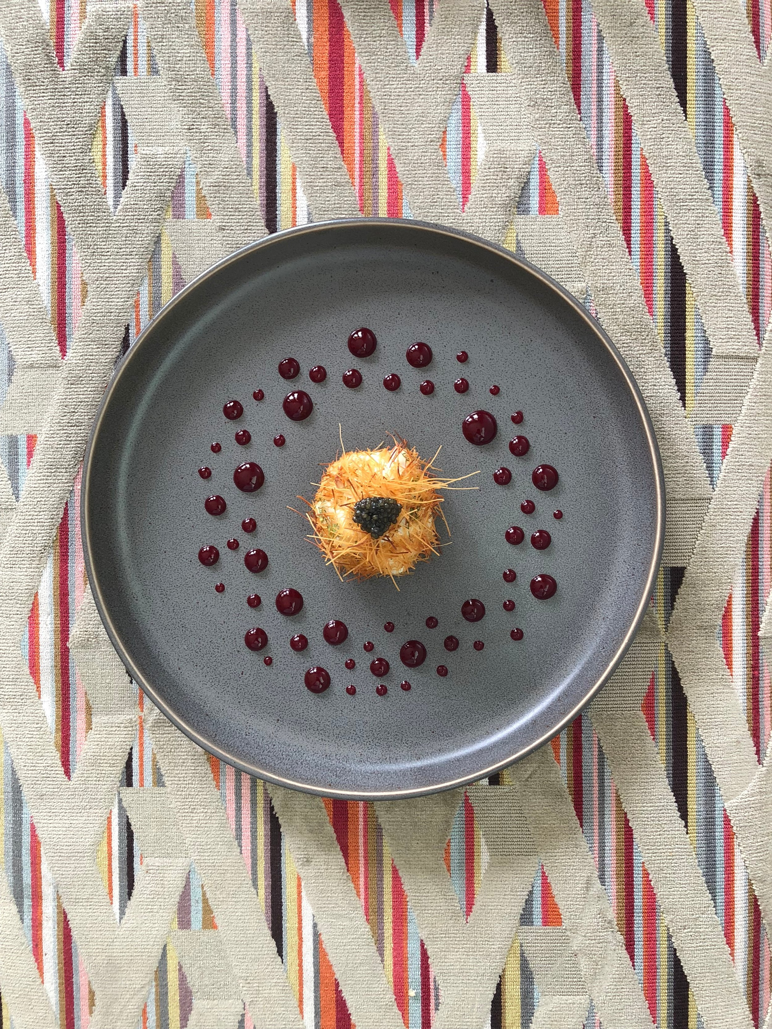 """Crab Crostillant with Raspberry Sauce: """"This is the first dish of hers that I fell in love with. I couldn't believe the flavors would work together. Such a mind bending combination that is just so Raji."""" - Erling Jensen  Photograph by Meredith Gardner"""