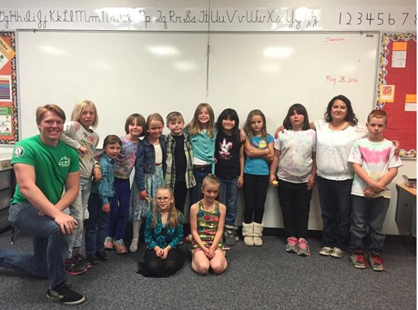 Hunter Good pictured next to the 3rd grade class he spent a year with while serving with AAI.
