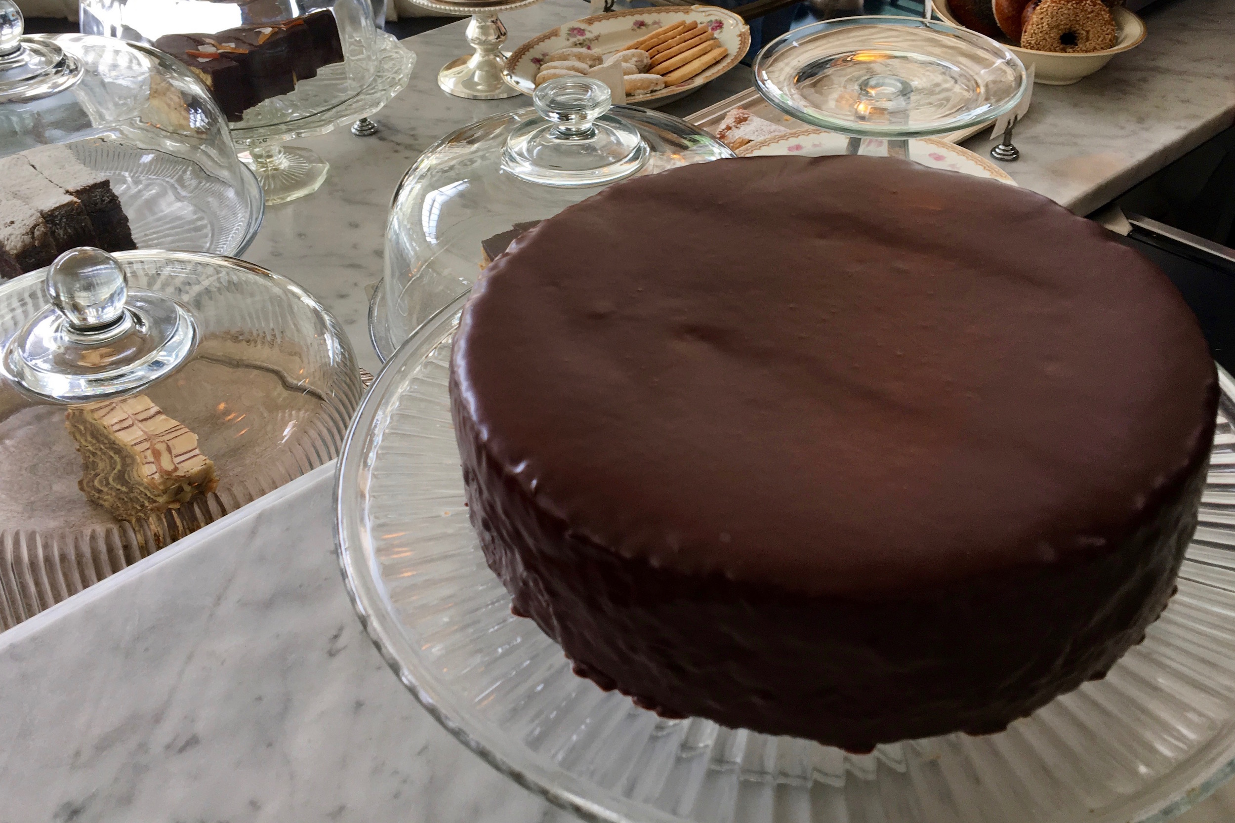 """yes! you may order a whole cake… - Many of our dessert favorites are also available wholesale. Please call the cafe during regular business hours to place an order:+1 (415) 621-2380Or for further enquiries, please send an email:20thcenturycafe@gmail.comround cakessacher torte two layers of chocolate made with almond flour, filled with royal blenheim apricot preserves and glazed with chocolate. serves 10-16. $75. dobos torte the most famous cake of hungaryseven layers of eastern european style cake with intense chocolate buttercream, topped with a fan of maldon salt flecked caramel. serves 18. $145.russian honey cake 9.5""""5-layer $65 serves 12-1610-layer $120 serves 16-24russian honey cake can be made as a tiered wedding cake. please inquire about pricing.rectangular cakes4"""" x 6"""