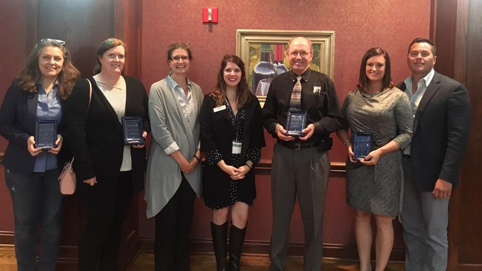 From left - Terri Sadler, Okie Mod Squad co-founder, accepting award for Lynne Rostochil, Amanda Regnier and Kary Stackelback, Oklahoma Archeological Survey, POK Executive Director, Cayla Lewis, Rick Lueb, TAP Architecture, Jackie and Chad Potter, Fire Station #13